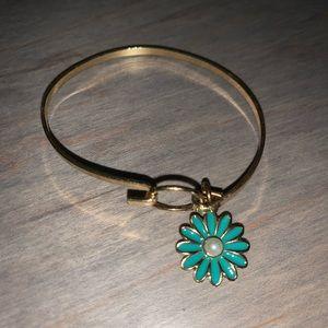 Gold bracelet w/ blue sunflower.